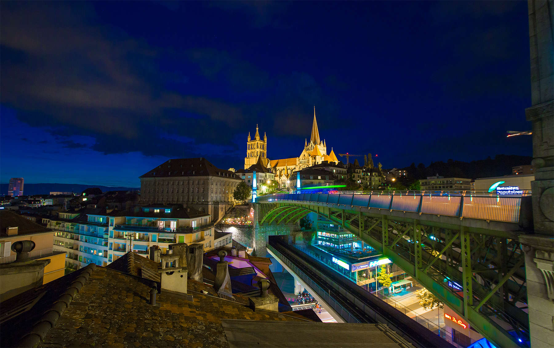 Beautiful view of the Lausanne Cathedrale and Bessiere bridge from the old town. The Lausanne Experience by Sylvain Botter, all right reserved